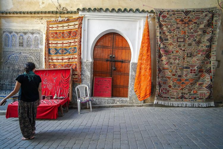 I want to try hanging out my rug outside my Brooklyn apartment just like this. Fes Morocco Medina Medina De Fez Fes Morocco Ancient Rear View Architecture Built Structure Real People One Person Building Exterior Full Length Building Entrance Day Arch Religion Men Door Adult Standing Clothing Lifestyles Leisure Activity Outdoors