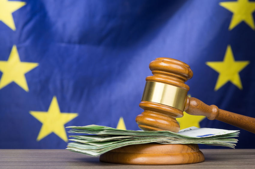 Euro banknotes with a wooden court gavel against european union flag as a concept of corruption in the judicial system Bribe Business Decisions European  Government Politics Union Agreement Banknote Bribery Concept Corruption Europe Flag Gavel Hammer Judgement Law Legal Liability Money Paying Reliability System Violation