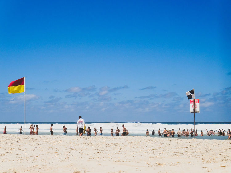 Adult Beach Beauty In Nature Cloud - Sky Day Flag Horizon Over Water Large Group Of People Leisure Activity Lifestyles Men Nature Outdoors People Real People Sand Scenics Sea Sky Summer Surf Vacations Water Waves, Ocean, Nature Live For The Story