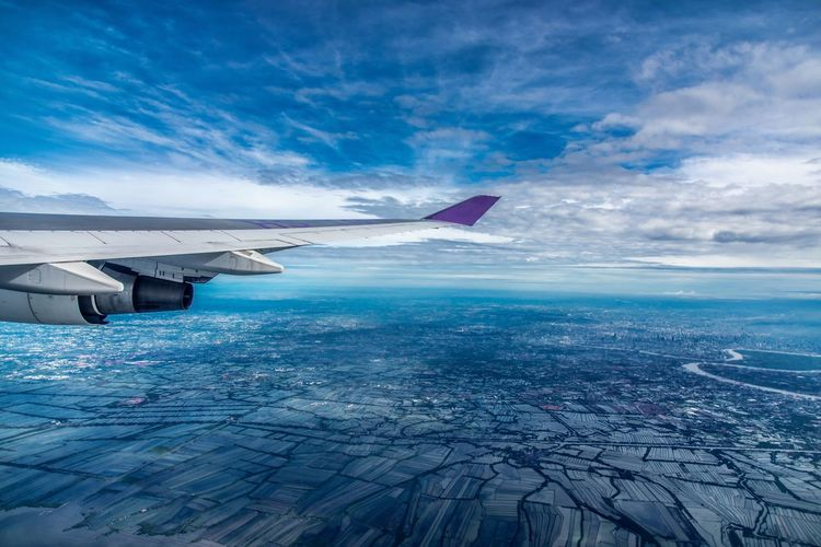 Flying to Thailand! EyeEm Selects Sea Travel Airplane Blue Outdoors Sky Travel Destinations Nature Flying