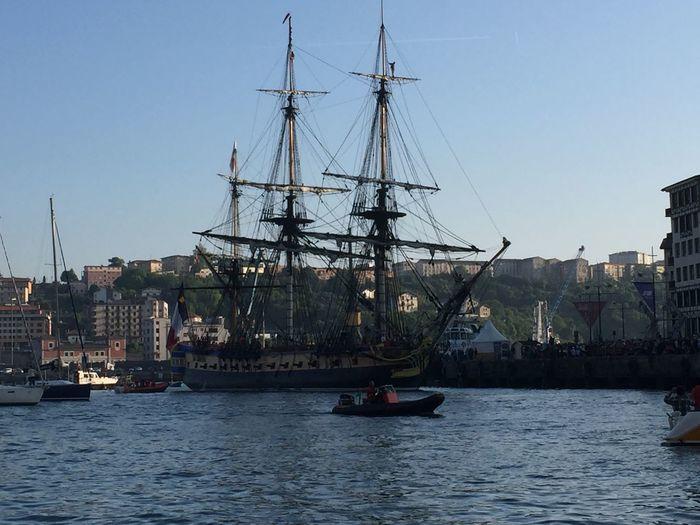 Sailboats sailing on sea against clear sky