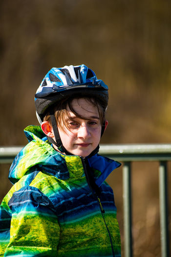 Portrait of boy wearing warm clothing and helmet