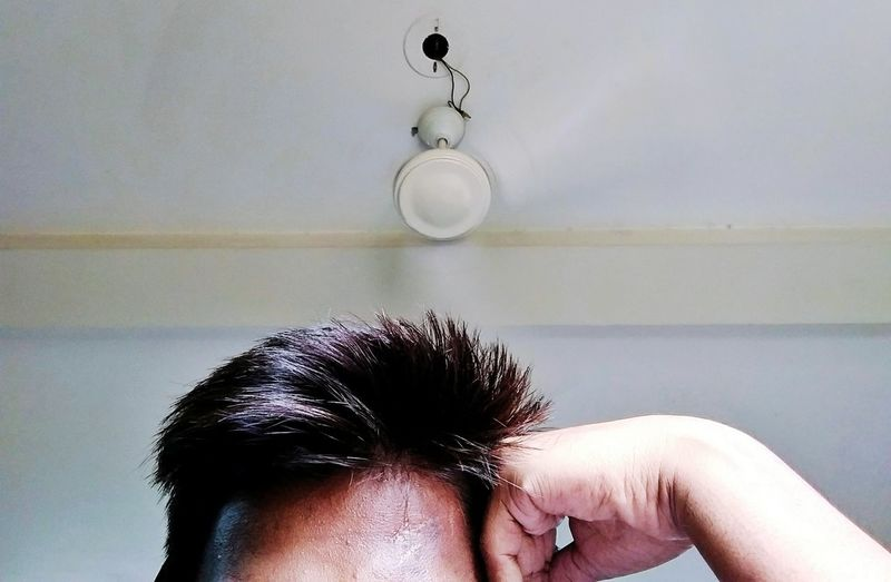 High section of man at home