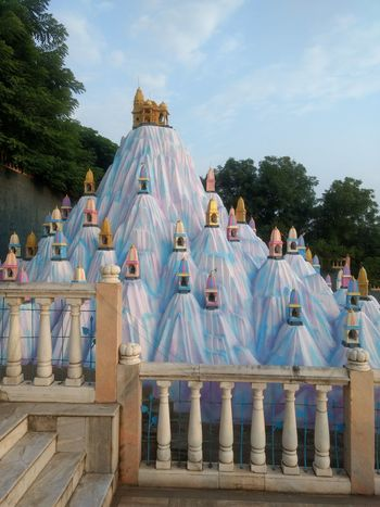 Blue Tree Outdoors People Day Sky Place Of Worship Jain Temple Spirituality Built Structure Cultures Hypnotized Worshipping God Jainism Building Exterior Architectural Design