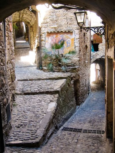 No People Eyeemphoto Tranquility Tranquil Scene Summer Alley Day Paved Narrow Narrow Street Old Buildings Buildings Italy Narrow Alleys Narrowpath Downtown Italian Village  Romantic Paved Street The Way Forward Adapted To The City