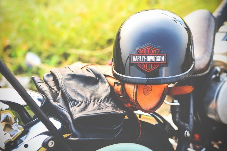 the helmet and the gloves - bikers accessories on the motorcycle seat Helmet Haley Davidson Grove Acsessory Road Safety Bike Motercycle Hemet  Street Protective Workwear Match - Sport Police Force Protection Text Politics And Government Motocross Motorsport Biker