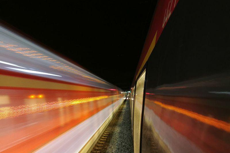 Light trails on train at night
