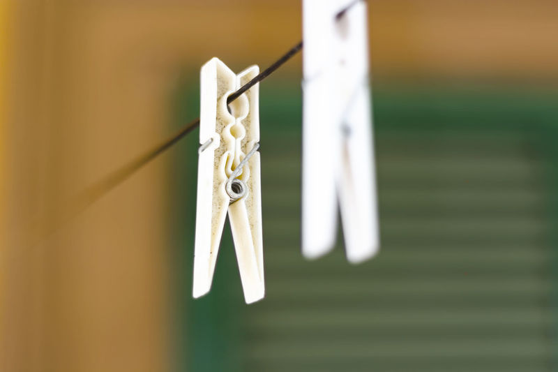 Close-up of clothes hanging on rope