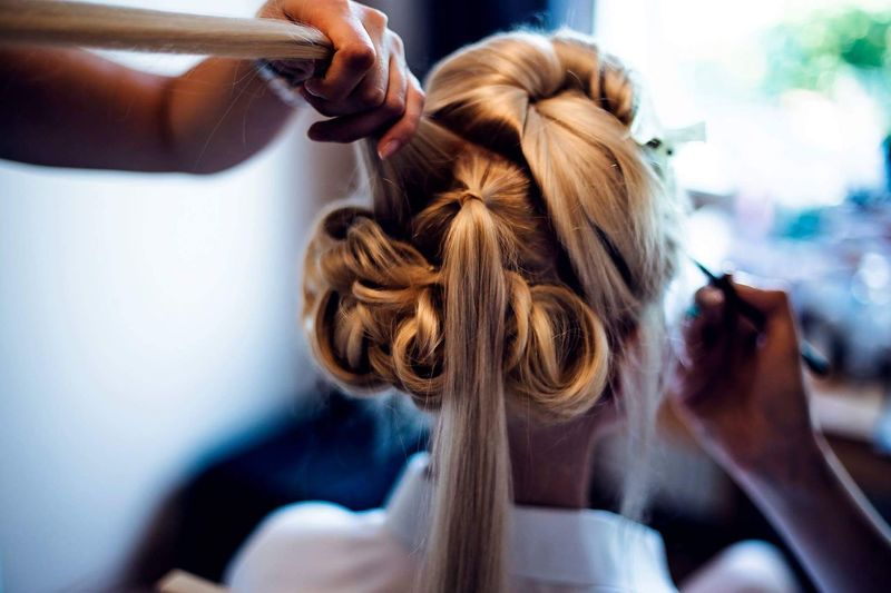 Cropped Hands Of Hairdresser And Beautician Preparing Bride For Wedding