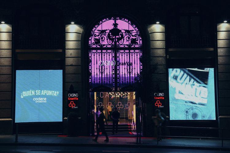 Entrance of illuminated building at night