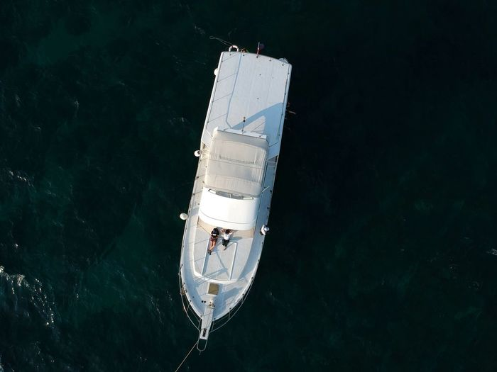 Drone view of yacht sailing in sea