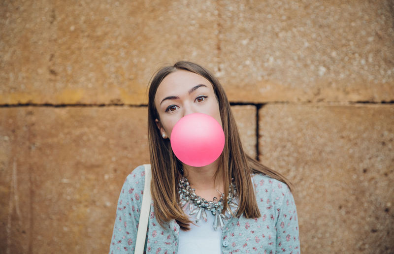 Portrait of a beautiful young woman with bubbles