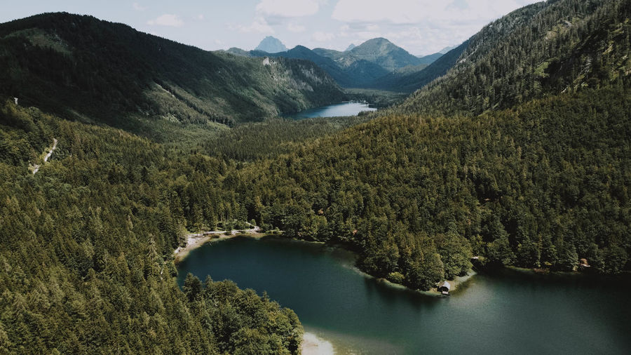 High angle view of lake amidst mountains against sky