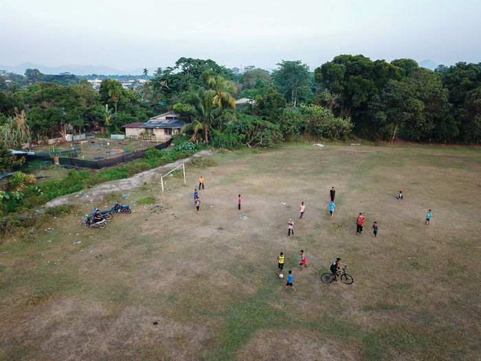 High angle view of people playing soccer against sky