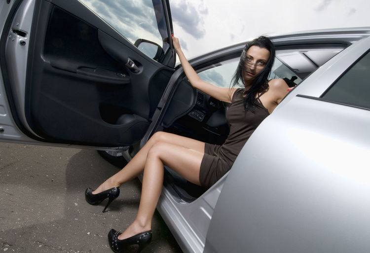 Woman Coming Out Of Car