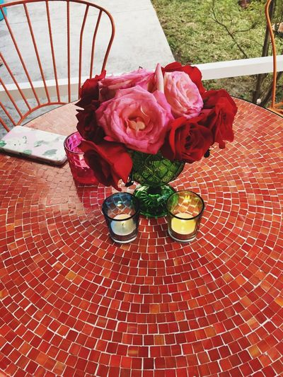 High angle view of red roses on table