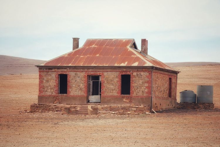 Rotting Clear Sky Sand Red Abandoned Old-fashioned Retro Styled Residential Building Deterioration Ghost Town Ruined Demolished Bad Condition Weathered Arid Climate Damaged