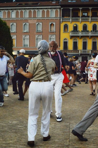 Let's swing Swing Dancing Love Togetherness Couple Streetphotography Happiness This Is Aging Men Women Togetherness City Palace Architecture Building Exterior Built Structure Parade Dancer Military Uniform Entertainment