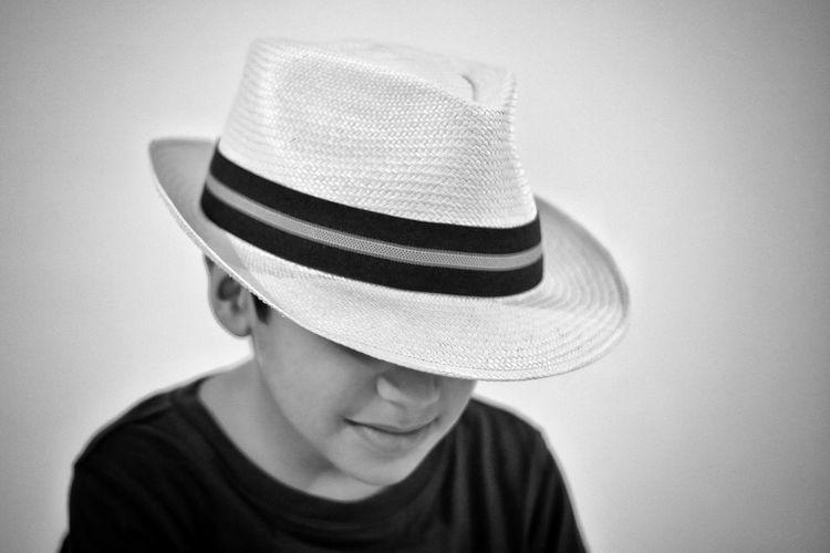 Boy Wearing Hat Against White Background