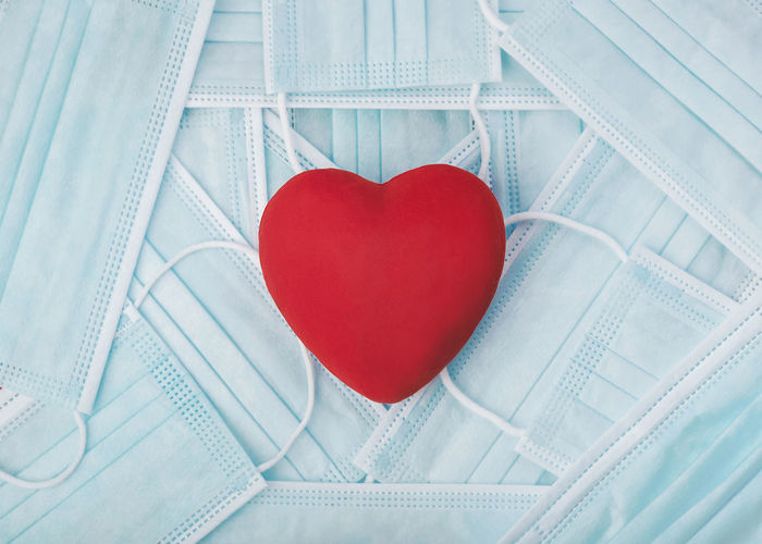 High angle view of heart shape made on white paper