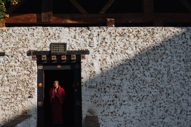 Bhutan, the world's only carbon negative country is also a traveler's paradise- from the mountains to the serene monasteries, it is culturally and naturally gifted. The Traveler - 2018 EyeEm Awards Travel Travel Photography Bhutan Color Monks Travel Destinations My Best Travel Photo This Is Strength