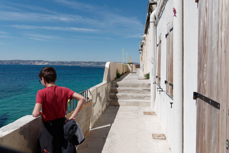Marseille Summer Summertime Sea Mediterranean  Blue Blue Color Clear Water Clear Clearness Beauty In Nature Nature Nature_collection Nature Photography Water Scenics - Nature Sky Day Outdoors Landscape Landscape_Collection Landscape_photography Architecture Architecture_collection Balcony Balcony View Residential Structure Horizon Real People One Person One Young Man Only Turquoise Colored Waterfront Tranquility Tranquil Scene