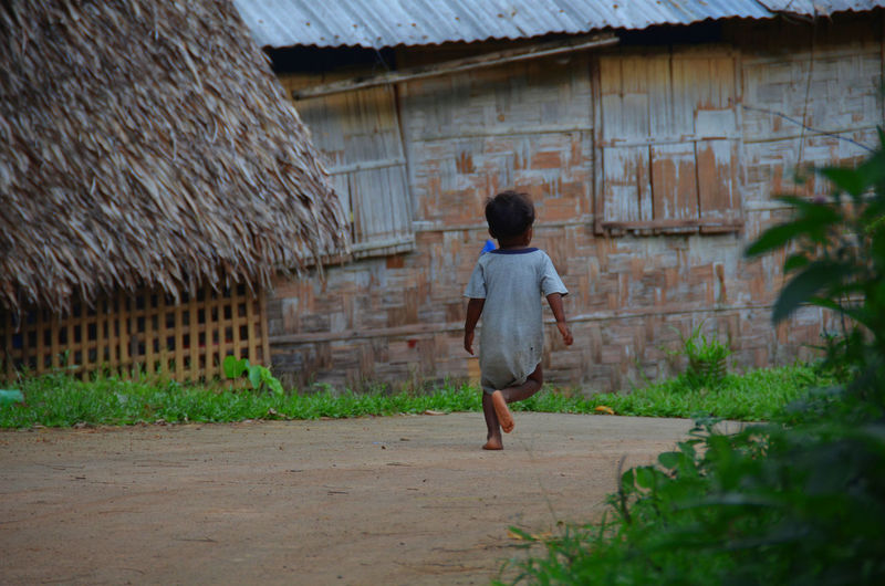Children FootPrint Philippines Running Rural Architecture Built Structure Casual Clothing Child Close-up Day Food Healthy Eating Lifestyles One Person Outdoors People Real People Rear View Rural Scene Urban Walking First Eyeem Photo