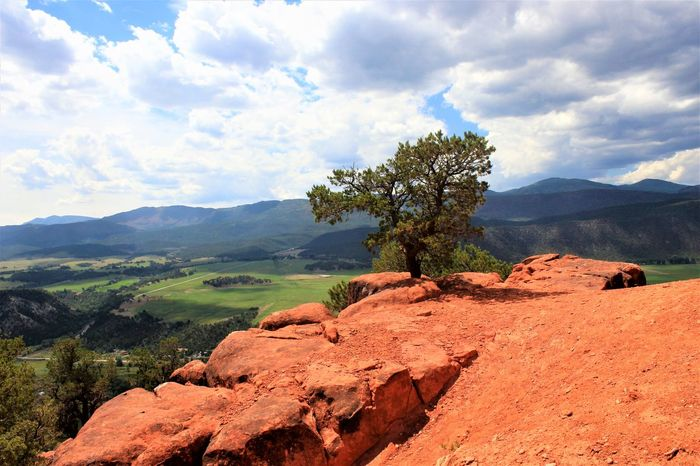 Sky Cloud - Sky Scenics - Nature Beauty In Nature Tranquil Scene Mountain Landscape Tranquility Environment Rock Non-urban Scene Nature Plant Rock - Object Tree Day No People Mountain Range Solid Idyllic Outdoors Arid Climate Mountain Peak Eroded