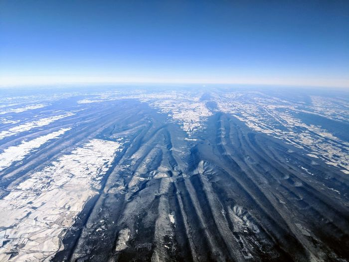 EyeEm Selects Full Frame Selective Focus Travel Travel Destinations Traveling Window Window Seat Snow Ice White Aerial View High Angle View Outdoors No People Blue Day Scenics Nature Sky Airplane