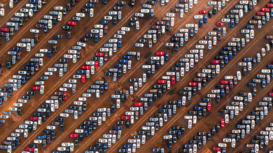 Aerial view of cars parked in parking lot