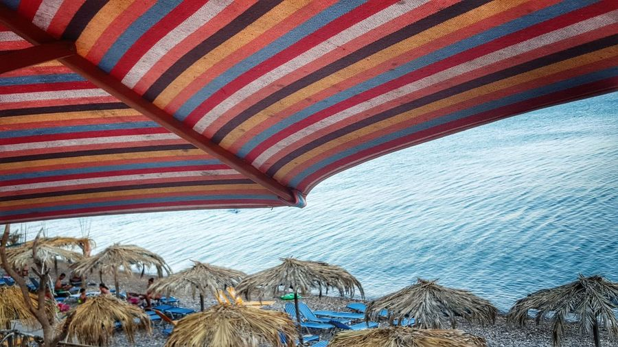 Beachphotography Colorful Umbrella Personal Perspective From Where I Stand Malephotographerofthemonth Stripes Everywhere On The Beach Stripes Pattern Beach Life Summer Views Calm Sea Peaceful View Perspective Photography Beach Umbrella - Chios Greece Miles Away