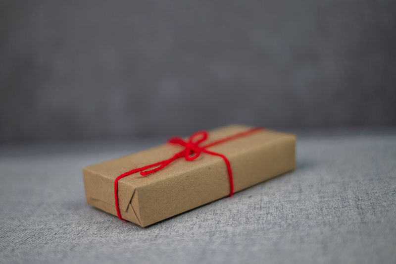 Close-up of red paper in box on table