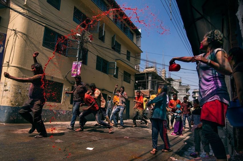 People throwing water to neighbours or even just passerby strangers as a part of Holi ( a hindu religious featival) celebration, kathmandu, nepal | 2014 The Moment - 2014 EyeEm Awards Holi Festival Color