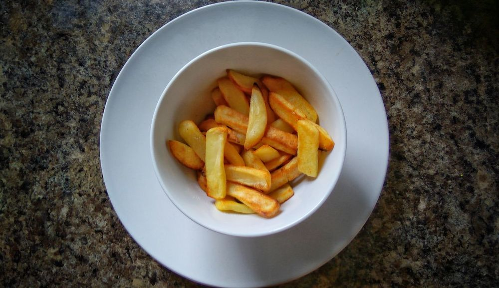 French Fries Prepared Potato Fried Food Food And Drink Snack Potato Chip Unhealthy Eating Bowl Ready-to-eat Fast Food Table No People Freshness Close-up Carbohydrate - Food Type Indoors  Day