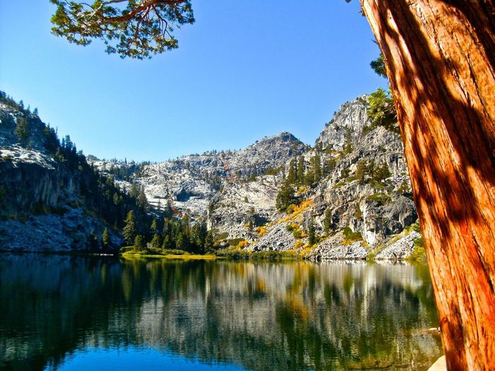 Lake in front of mountains against clear sky at desolation wilderness