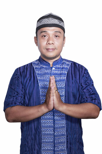 Portrait Smiling asian muslim man on white background Adult Casual Clothing Day Front View Happiness Lifestyles Looking At Camera One Person People Portrait Real People Smiling Standing Studio Shot White Background Young Adult Young Men