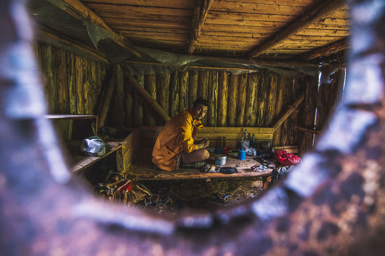 Man Sitting In A Shelter