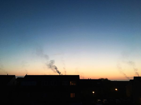 Suburbia Awakens Silhouette Emitting Iphone6s EyeEm IPhoneography Clear Sky House Built Structure Smoke Stack Factory Building Exterior Chimney Architecture Air Pollution Fumes Environment Sunset No People Clear Sky Smoke - Physical Structure Outdoors Sky Ecosystem  Nature