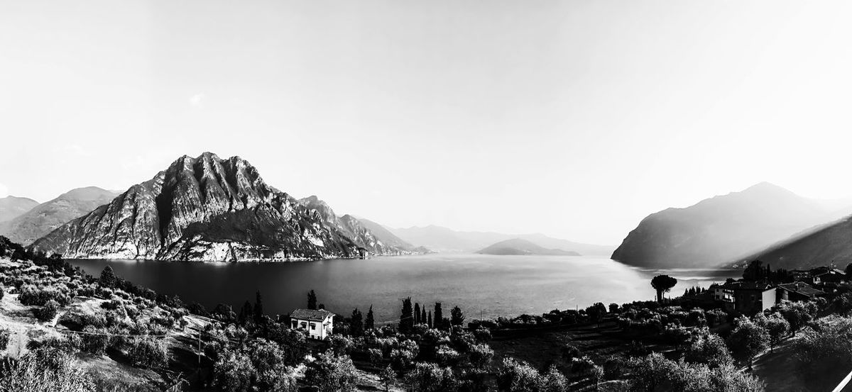 Just a landscape. Travel Destinations IPhoneography IPhone Panoramic Iseo Lake Italy Lakescape Blackandwhite Photography Landscape View Lake Mountain Peak Sky Mountain Beauty In Nature Water Scenics - Nature Tranquility Mountain Range Nature Tranquil Scene Day Tree No People Plant Non-urban Scene Outdoors Idyllic Bay EyeEmNewHere