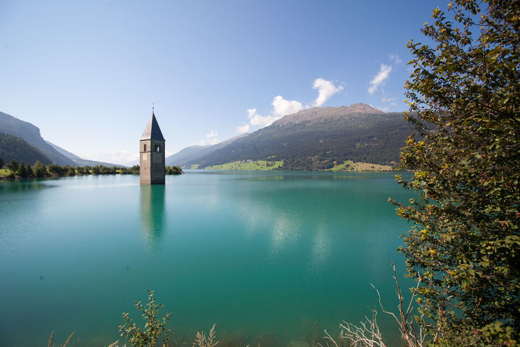 lake resia Architecture Beauty In Nature Belief Building Building Exterior Built Structure Day Lake Lake Resia Mountain Nature No People Outdoors Place Of Worship Plant Religion Resia Resia Lake Scenics - Nature Sky Tree Water