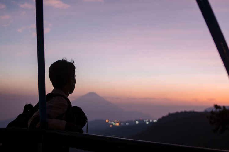 Portrait of silhouette man looking at sunset