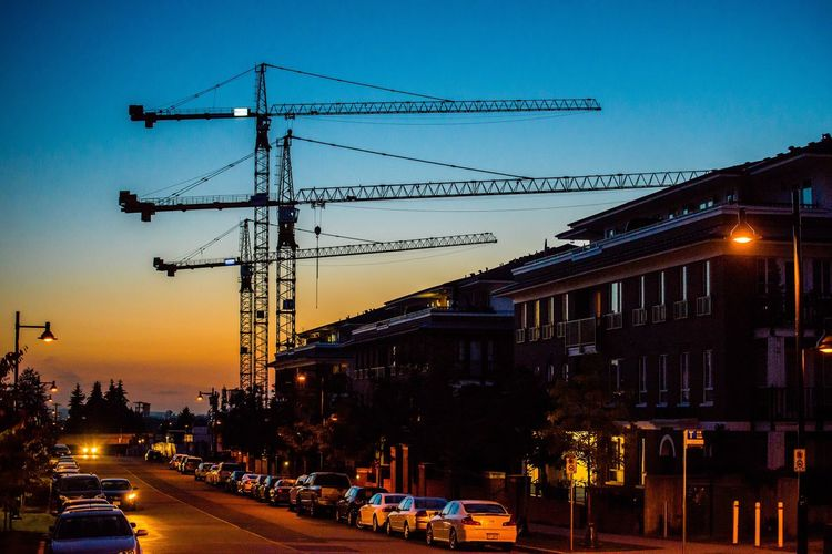Architecture Transportation Built Structure Building Exterior Land Vehicle City Street Car Outdoors Dusk Mode Of Transport Street Light Illuminated Sunset No People Road Clear Sky Sky Cityscape Day From My Point Of View EyeEm Best Shots