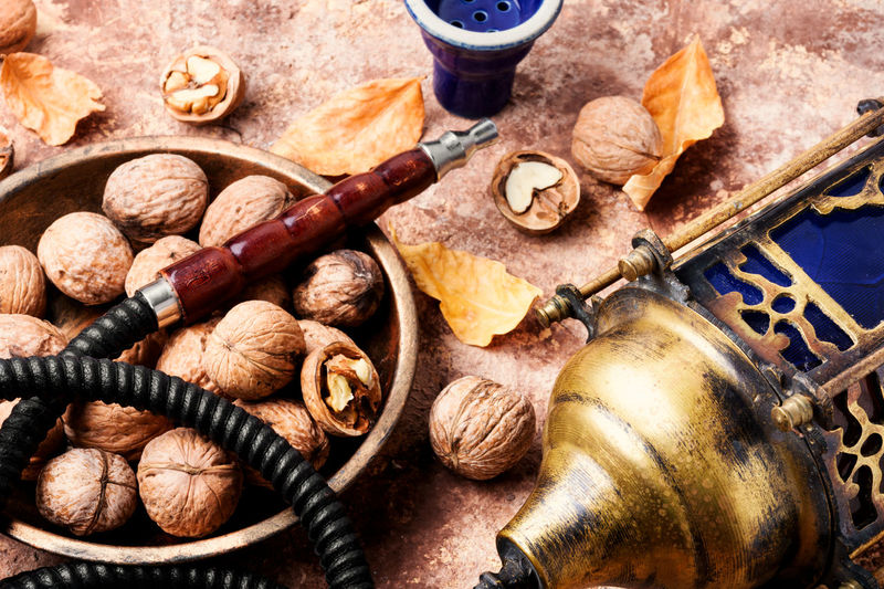 Turkish shisha hookah with flavor walnut for relax. A New Beginning Hookah, Grape, Shisha, Walnut, Nut, Smoking, Tobacco, Nargile, Smoke, Nicotine, East, Relaxation, Fruit, Arabic, Mouthpiece, Pipe, Retro, Fragrant, Pastime, Hookah With Walnut, Turkish, Smoke Shisha, Hookah Lounge, Lifestyle, Exotic, Leisure, Hookah Pipe, No People Food And Drink Food High Angle View Close-up Choice Large Group Of Objects Wine Cork Variation Cork - Stopper Drink Abundance Indoors  Kitchen Utensil Walnut Fruit Work Tool Still Life Corkscrew Day