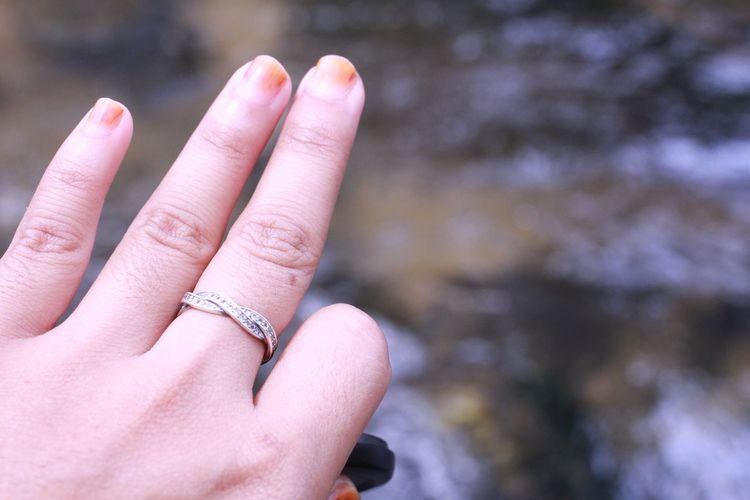 Cropped image of woman wearing ring