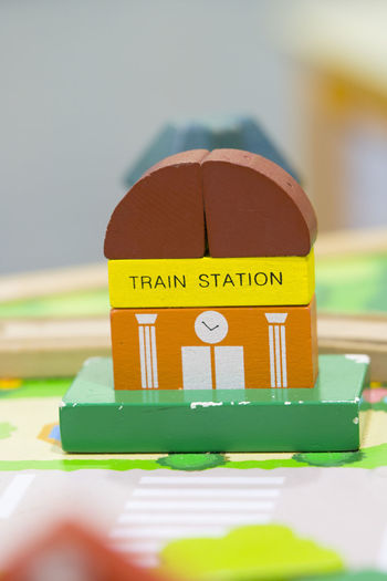 Train Station Wooden Toy model Play set Educational toys for preschool indoor playground Close-up Selective Focus Hand Toy Text Indoors  Yellow Still Life Focus On Foreground Multi Colored Green Color Childhood Temptation Train Station Wooden Toy Toy Model Educational Toys Preschool Building