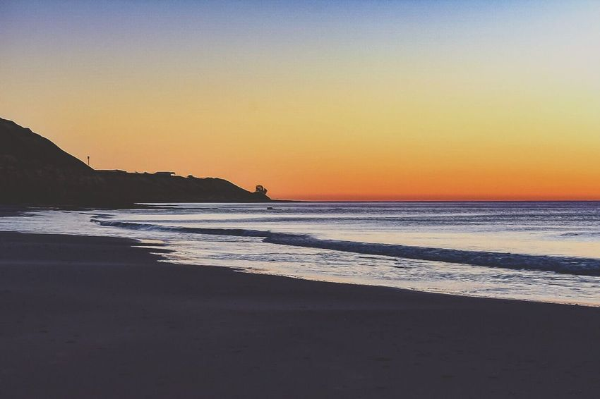 Sea Beach Sunset Scenics Water Nature Beauty In Nature Tranquil Scene Sand Tranquility Shore Horizon Over Water Orange Color Wave Idyllic Silhouette Outdoors Clear Sky Sky Vacations