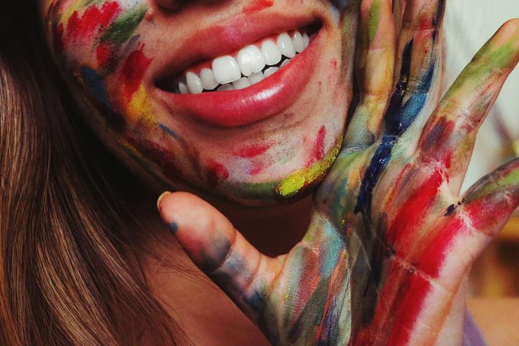 Midsection of woman covered with paint