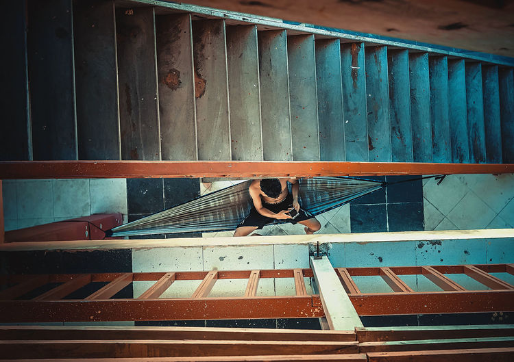 High angle view of man on staircase
