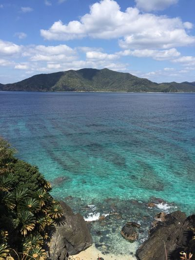 Sea Scenics Water Cloud - Sky Nature Beauty In Nature Outdoors Sky Idyllic Mountain No People Travel Destinations Day Tranquility Tree Beach Blue Water Blue Sea Kagoshima Amami Island