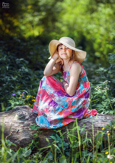 Person Sitting Casual Clothing Focus On Foreground Green Color Relaxation Beauty Day Summer Contemplation Outdoors Girl Eidsvoll Sunny Forrest Dress Colorful Colors Smile Hat Grass